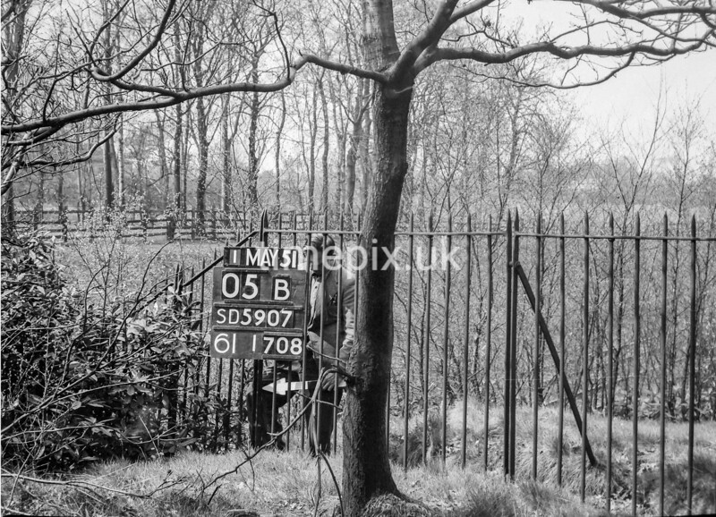 SD590705B, Man marking Ordnance Survey minor control revision point with an arrow in 1950s
