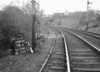 SD570878A, Man marking Ordnance Survey minor control revision point with an arrow in 1950s