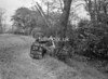 SD570859B, Man marking Ordnance Survey minor control revision point with an arrow in 1950s