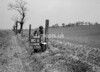 SD580880B, Man marking Ordnance Survey minor control revision point with an arrow in 1950s