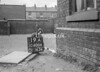 SD600619A, Man marking Ordnance Survey minor control revision point with an arrow in 1950s