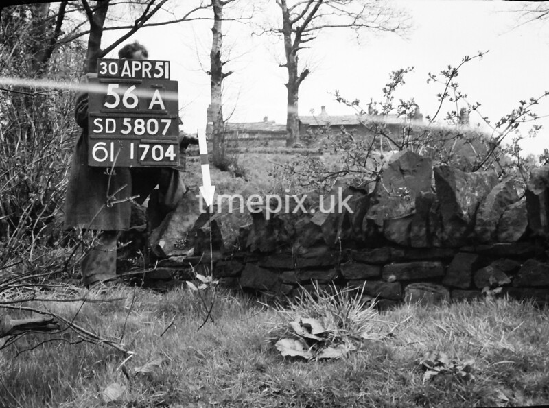 SD580756A, Man marking Ordnance Survey minor control revision point with an arrow in 1950s