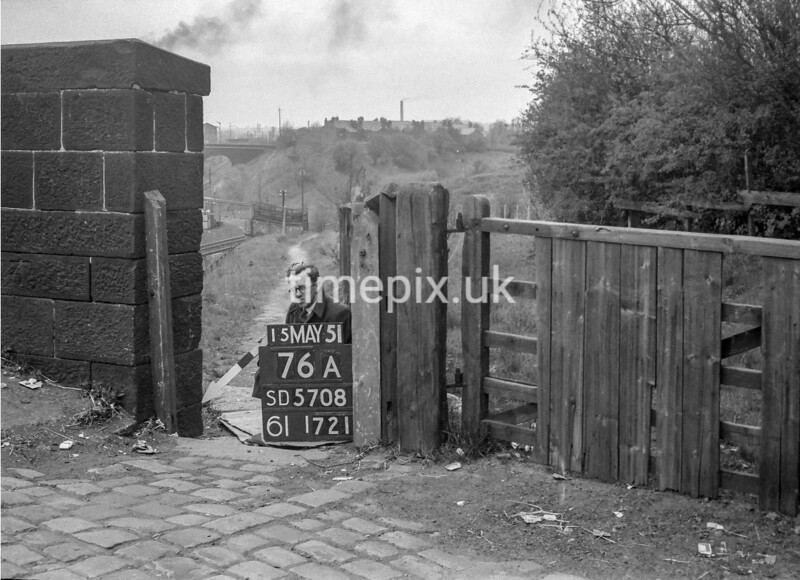 SD570876A, Man marking Ordnance Survey minor control revision point with an arrow in 1950s