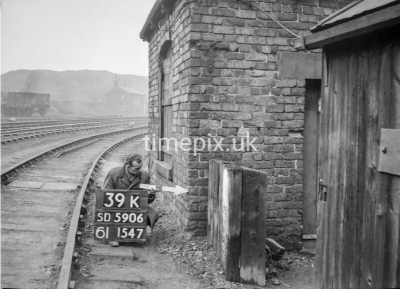 SD590639K, Man marking Ordnance Survey minor control revision point with an arrow in 1950s