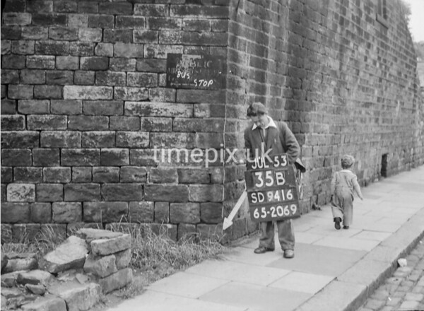 SD941635B, Man marking Ordnance Survey minor control revision point with an arrow in 1950s