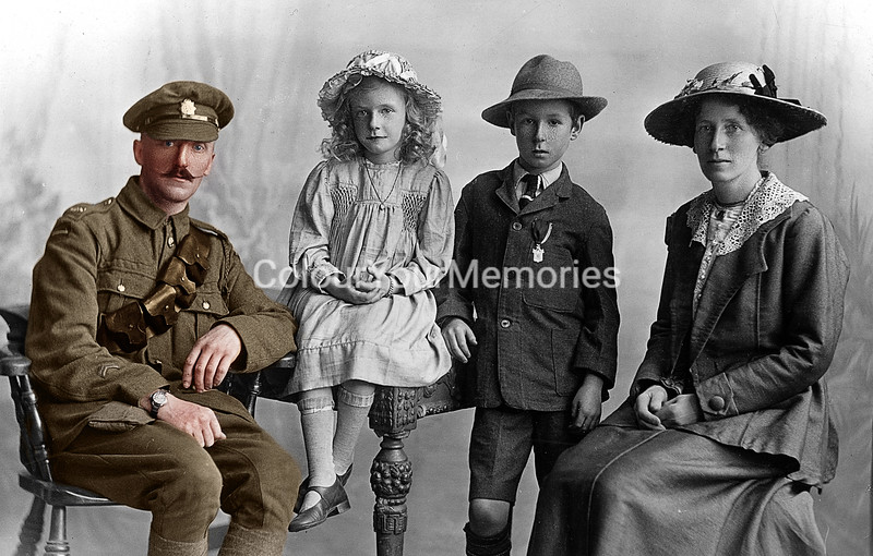 WW1 Dad's going to war. Family photo for which no one can muster
