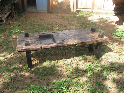 Organic coffee table. made of reclaimed peice from a primitive country mine. and dark wood legs.