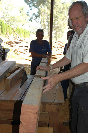 Marcel Maison assisting in the manufacturing process, as we start cutting up an antique beam of bruna, a lovely heavy wood almost black in color with the odd yellow vein!