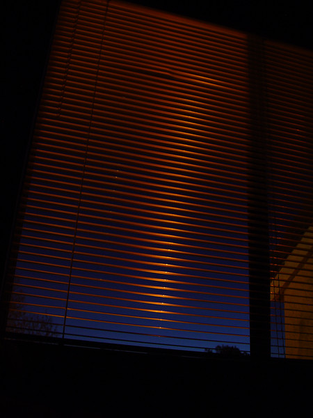 sunset (or almost after) hitting the mini-blinds of an old apartment.