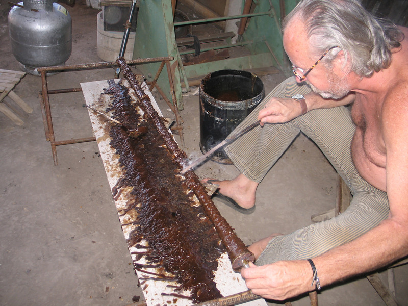 Marcel Maison making wax molds in the foundry.