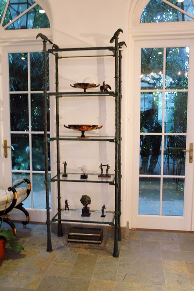 Giacometti style shelving unit made to display client´s collections of Roman antiquieties.