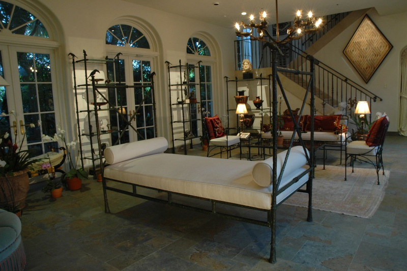 Bronze Day bed, in Giacometti style with toucan finials and matching shelfing units.
