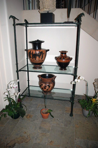 Giacometti style display unit made to display client´s collections of Roman antiquieties.