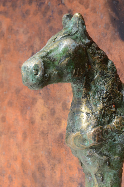 Detail of horse head on outdoor planter.