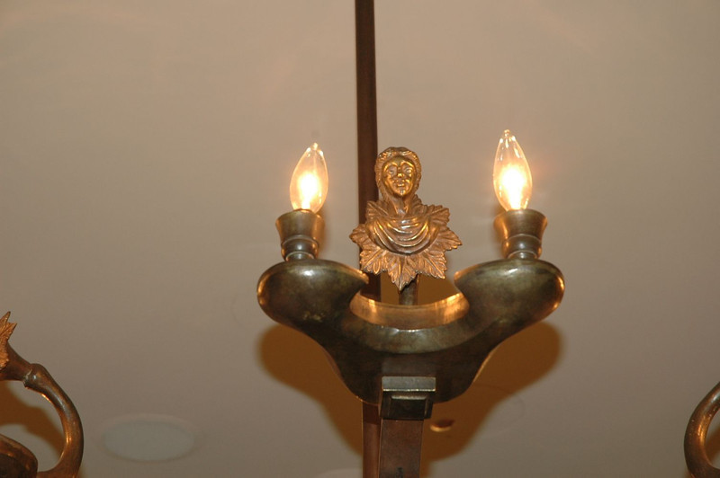 Details of bronze chandelier incorporating casts of antique Roman oil lamps.
