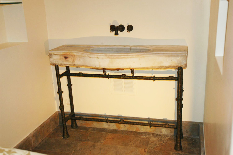 Antique Ottoman marble sink on customized bronze stand in Giacometti style.