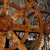 "<font size=""3""><i>Cogs of Industry</i></font> <font size=""1"">Rusted gear assembly, circa 1840, from a water-powered textile mill in Lowell, Mass., along the Merrimack River</font><br>"