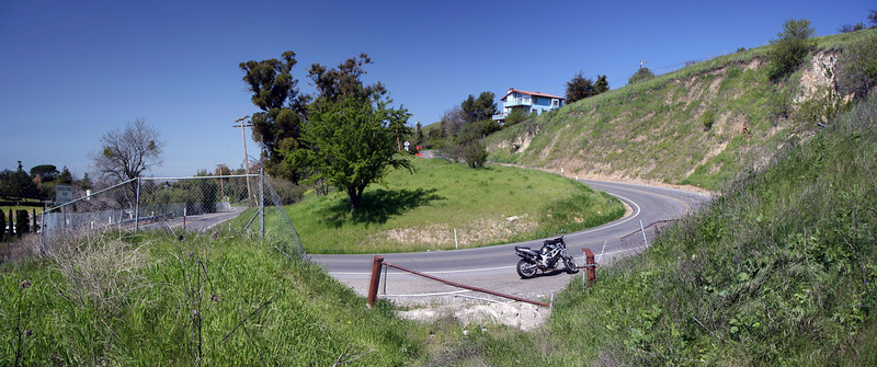going up the hill, it just progresses into sweeping twisties, with this u-turn as the one of the first major corners.<br /> <br /> two shot panoramic stitched w/ autostitch