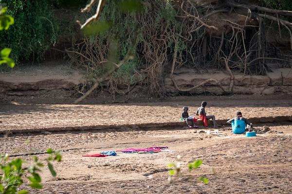 Samburu people digging for water