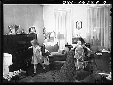 Buffalo, New York. Patsy Grimm, age six, dusting and Mary Grimm, eight, sweeping in the front room.