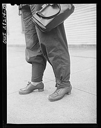 Buffalo, New York. Mrs. Grimm, a twenty-six year old widow with six children under twelve, works as a crane operator in a war plant.