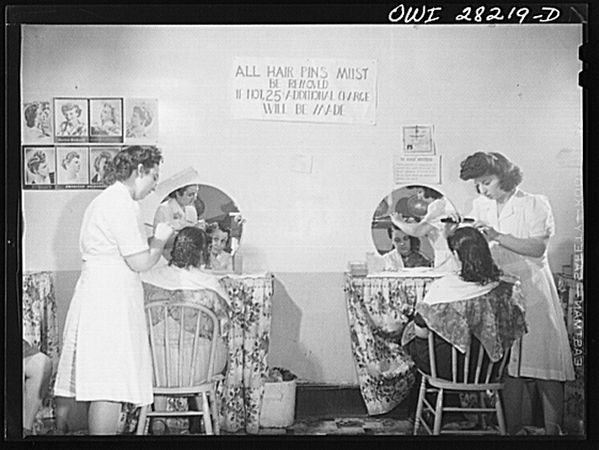 Mrs. Grimm, a twenty-six year old widow with six children who is a crane operator at Pratt and Letchworth, having her hair done after work