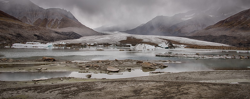 We have reached the melt pond at the foot of the glacier, and clouds continue to drop.
