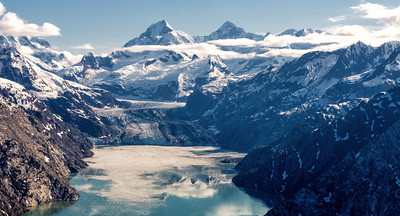 Within Glacier Bay, on the northeastern edge of the robust Fairweather Range, you'll enter the Johns Hopkins Inlet, home to no less than nine glaciers. Framed by rocky slopes that stretch skyward more than 6,000 feet, these wondrous bodies are eclipsed only by the mighty Mount Fairweather itself, which at more than 15,300 feet is the highest point in southeast Alaska.