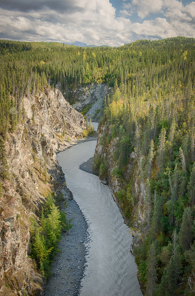 The depth of the canyon likely precluded the use of more traditional timber pilings. The river that runs 238' below is fed from several glaciers on the southern and western slopes of Mt. Blackburn,
