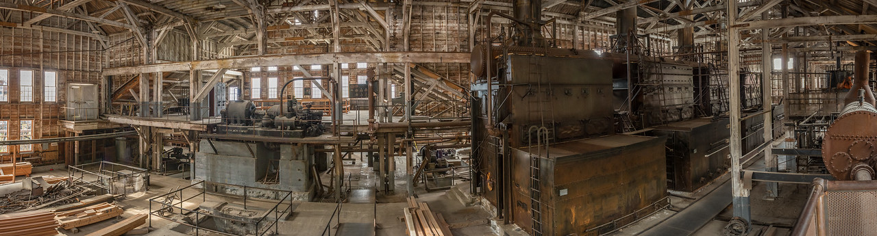 This is a wide angle composite of four photos, detailing the interior of the power plant. Four furnaces, diesel generators and pelton wheel all served to guarantee something would provide sufficient power for the needs of the town. We toured the interior at the ground level a little later in the day.