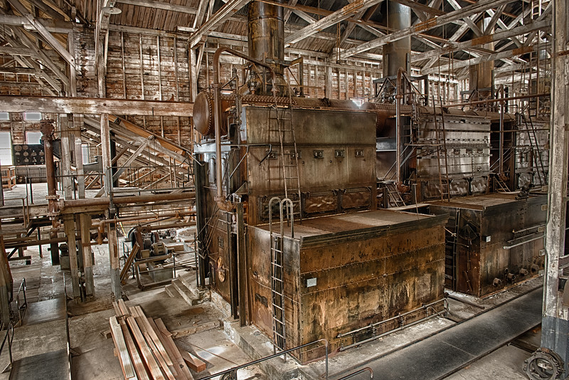 A line up of four ginormous boilers supplied the lion's share of power to the mines. There were also diesel generators and pelton wheels.