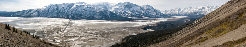 Panorama of the Slims River Valley in Kluane National Park. The road is the newest version of the Alaskan Highway.