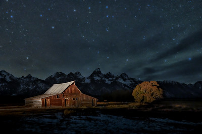 The iconic Molten Barn, illuminated under the stars in Teton National Park