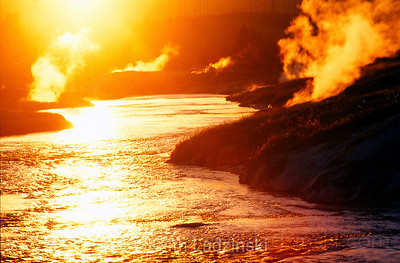 Sunset on the fire hole river in yellowstone national park, Wyoming. This back lit image presents a firey representation staying true to the river's name. 80% of the geyser and hot pool run off in the park makes its way into the fire hole river