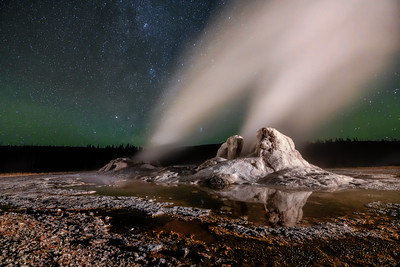 Castle Geyser errupting under the stars, Yellowstone National Park