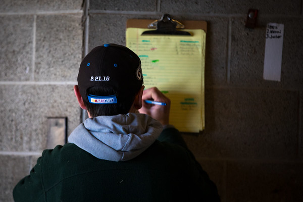 Rodolphe Brisset checks the list for the horses under his care.