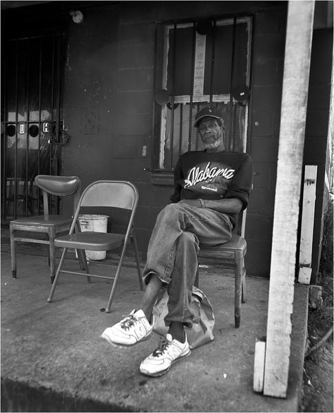 Alabama April 2007 Man with Alabama Shirt on Porch