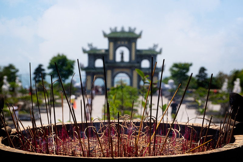 Burning Incense In Front Of A Temple
