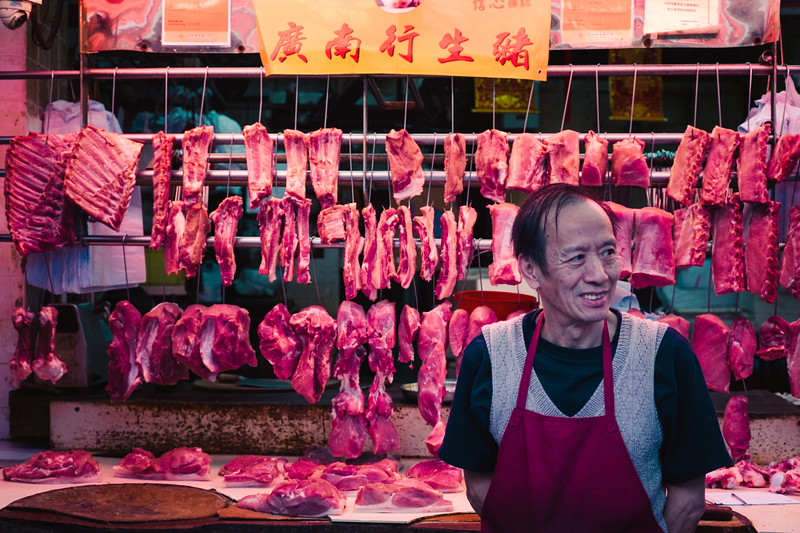 Butcher At A Wet Market In Central Hong Kong