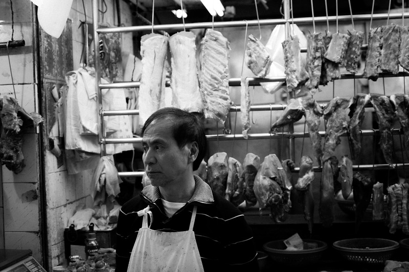 Butcher At A Meat Market In Central Hong Kong