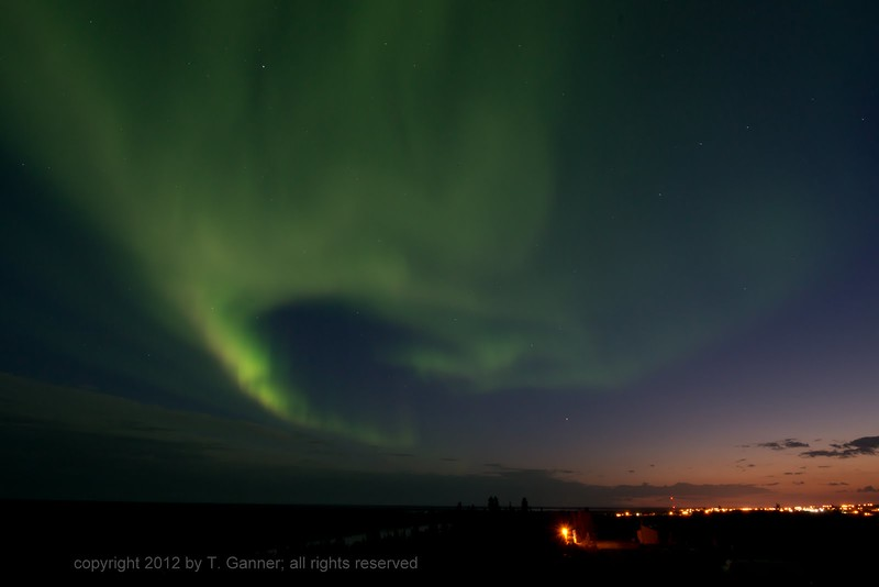 The northern lights and the lights of Inuvik at sunrise, at about 2:30 a.m. Long days up north!