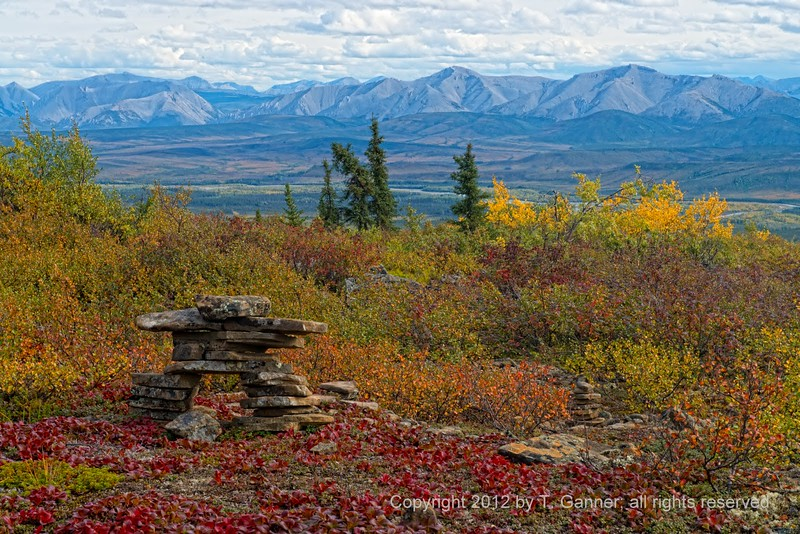 Inuksuk overlooking the Ogilvie Mountains from Eagle Plains along the Dempster Highway.