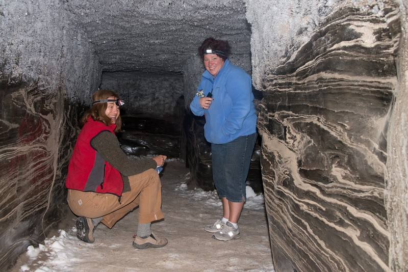 Tunnels are carved into the permafrost. Walls are solid ice, and the variegation is dirt extruded from the ice.