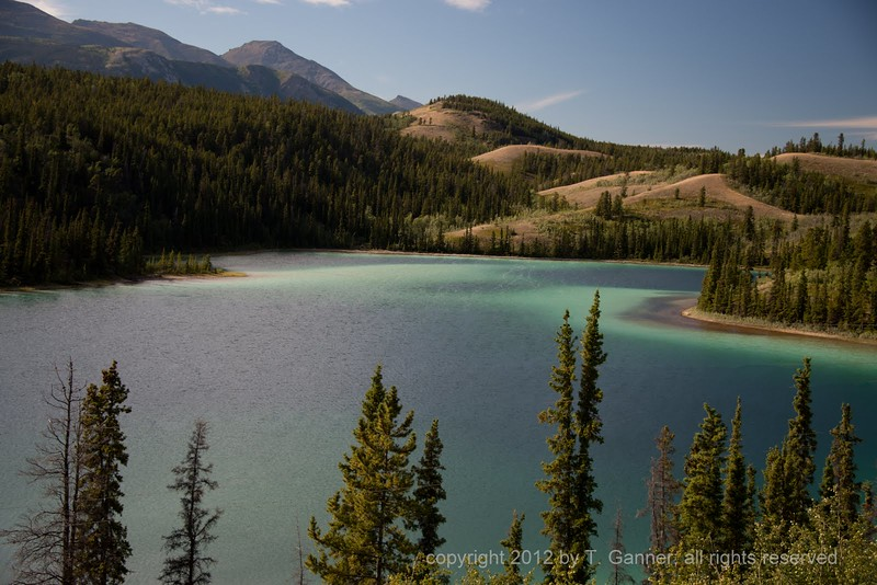 Marl (calcium carbonate deposits) in this lake give it an other-worldly varigation of color.