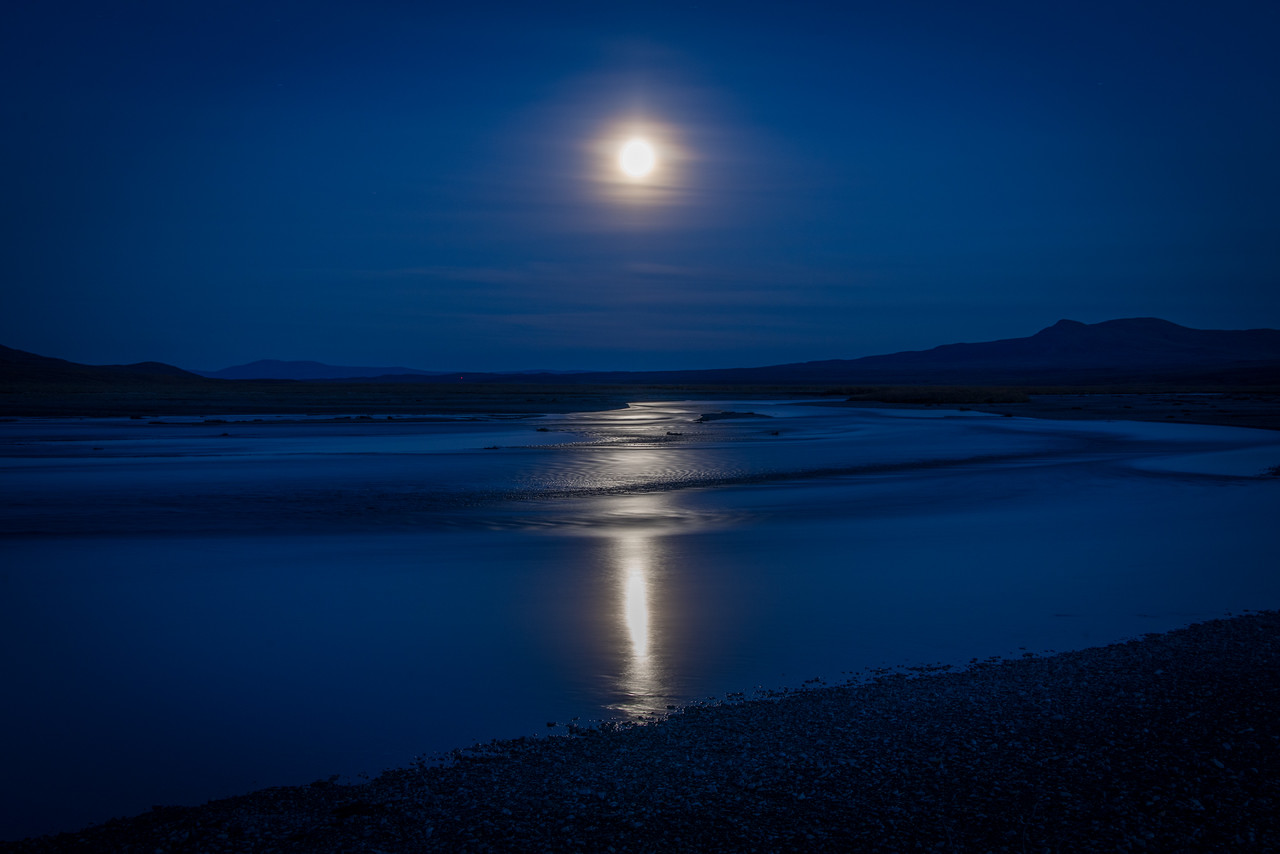 A perfect end to a perfect day, enjoying the moonlight reflection on the Maclaren River. The haze around the moon looked like a fur collar framing an Inuit face.