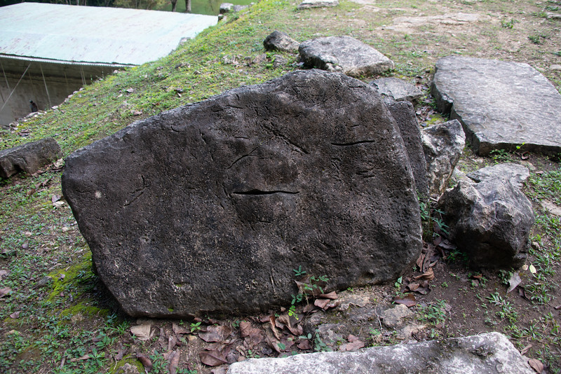 To the best of my understanding, the cracks in this stone may be the result of decapitation during human sacrifice