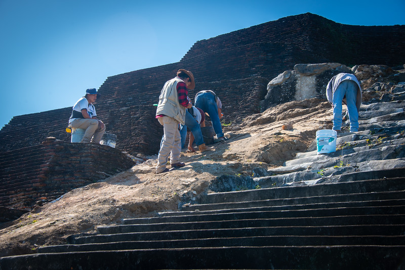 The supervising archaeologist, who was able to afford wearing a wool shirt and vest while others did the work.