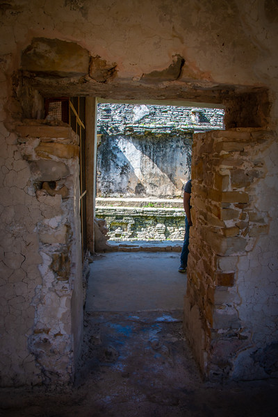 I was fascinated by the T-shaped doorway and windows. This is the same style of doorway common to Anasazi pueblos of the southwest. One might imagine it gave room for a header, though the passageway seemed too deep for this to be space for a header, and many doorways seemed to lack this feature.