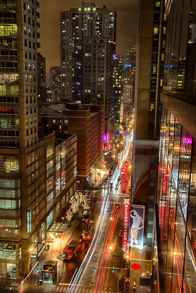 Chicago at night. From the 18th floor of a boutique hotel facing the intersection of Grand and State. It is amazing to see all the activity at such a late hour but to open the shutter and allow Chicago and all the city life to stream in really gives the viewer a sense of action and energy.
