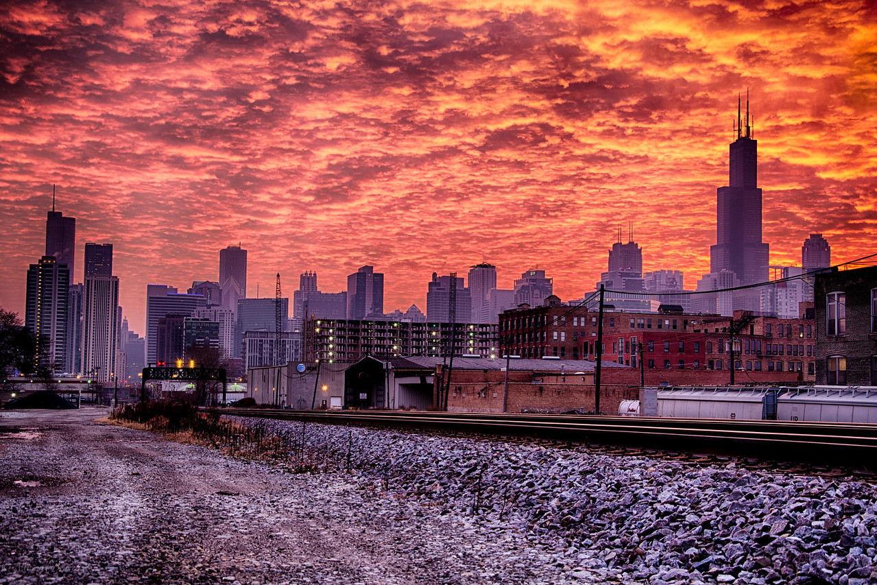 Shot on a very cold November morning as the sun was obscured by the clouds and they sat over the city. The frame really changed as the sun poked through the clouds. To see the sky light up as it did this morning was a gift. The first that seemed to emanate from the city was astonishing. Sunrise shots are always different in the city of Chicago. When you are shooting downtown Chicago around Sunrise you have to get there early enough to catch the pre-sunrise light, just like the post sunset light, it can sometimes be the best time to capture the city. Shot 12-1-13 as the sun rose over the city of Chicago, Illinois.
